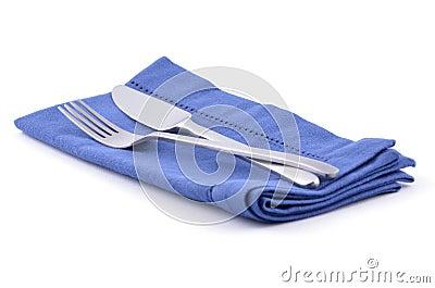 Knife and fork on blue napkin