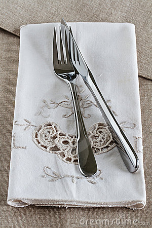 Knife and fork on linen