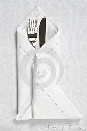 Knife and fork with linen napkin