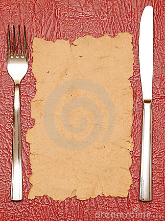 Knife and fork on old paper