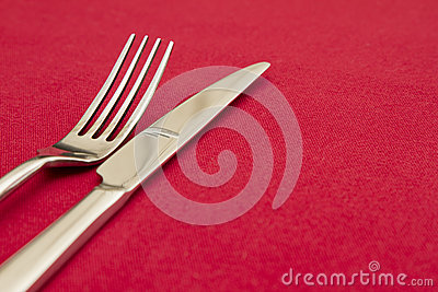 Knife and fork on red