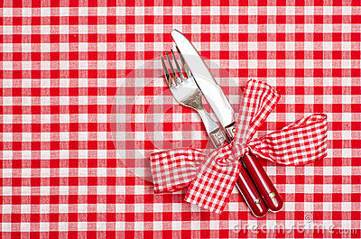 Knife and fork with red checkered bow