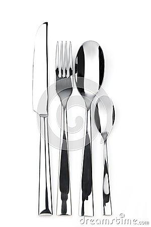 Knife, fork, spoon and teaspoon