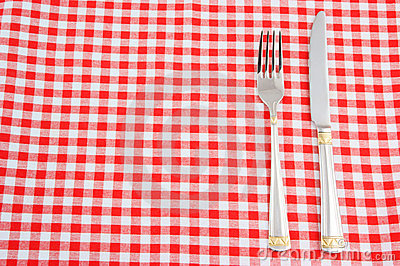 Knife and fork on tablecloth