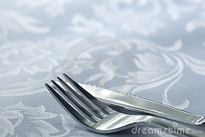 Knife and Fork on White Linen