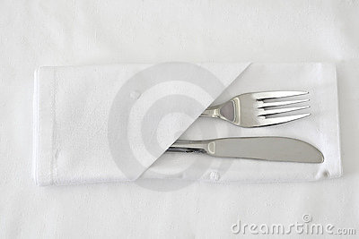 Knife and Fork with white table linen