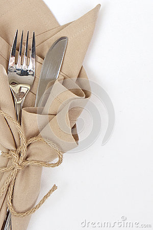 Knife and fork wrapped with string