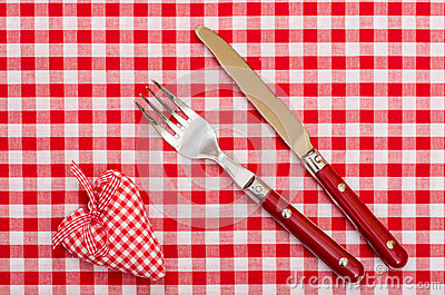 Knife and fort with red checkered heart and bow