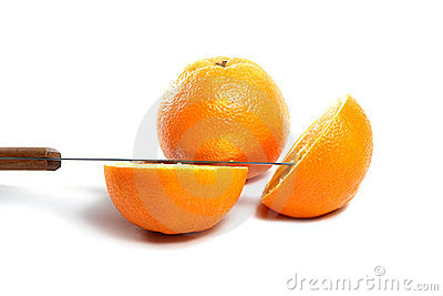 Knife and orange cut half-and-half