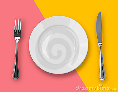 Knife, plate and fork on colorful top view