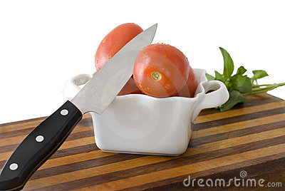 Knife, Tomatoes, Cutting Board on White