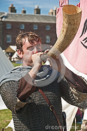 Knight blowing large horn Editorial Stock Photo
