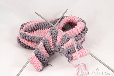 Knitted slipper and knitting-needles