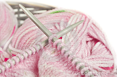 Knitting a pink baby jersey - yarn and needles