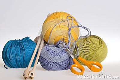Knitting, yarn and scissors