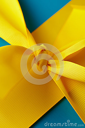 Knot in yellow gift ribbon