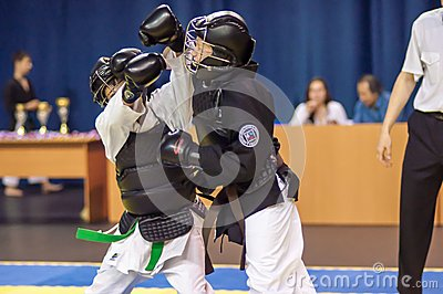 Kobudo competition between boys Editorial Stock Image