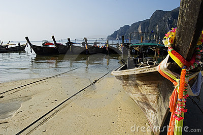 Koh Phi Phi, long-tails boats and colored ribbons Editorial Photography