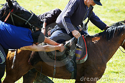 Kokpar - traditional nomad horses competitions Editorial Stock Photo