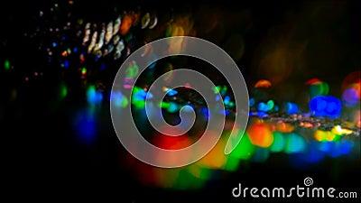 Kolorowy obiektywu raca okrąża nocy światła odbija zbiory wideo