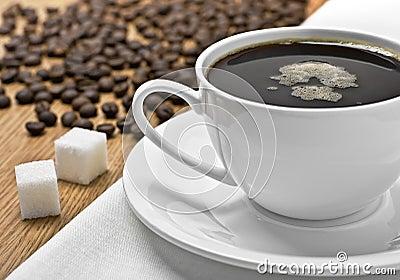 Kop van koffie op een tafelkleed