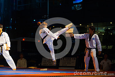 Korean Taekwondo Girl Jump Kicking Breaking Board Editorial Photography