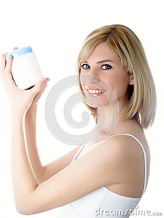 Kosmetikglas in einer Hand