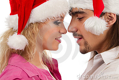 Kssing couple in Christmas hats