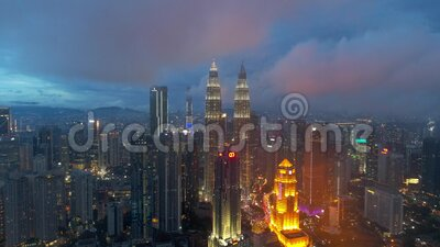 4k footage Aerial view of buildings and landmarks centre Kuala Lumpur city, during day to night at Kuala Lumpur, Malaysia. stock video footage