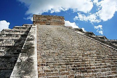 Kukulkan Pyramid in Chichen-Itza by blue sky