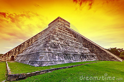 Kukulkan pyramid in Chichen Itza at sunset