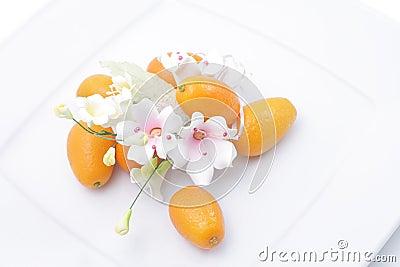 Kumquats and flower