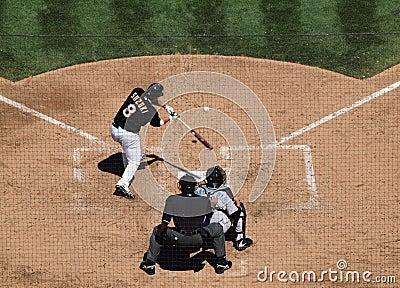 Kurt Suzuki swings at incoming pitch Editorial Stock Image
