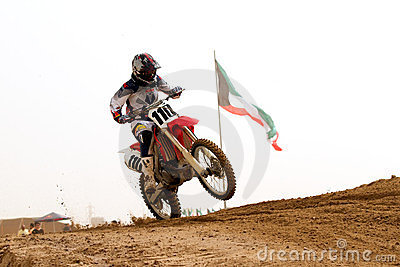 Kuwait motorcross with the Kuwait flag Editorial Stock Photo