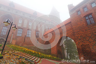Kwidzyn castle and cathedral in foggy day
