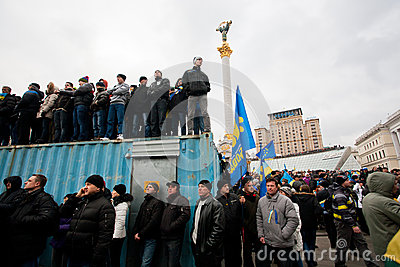 KYIV, UKRAINE: Crowd of the demonstrators occupying trailers standing on anti-government demonstration Editorial Image
