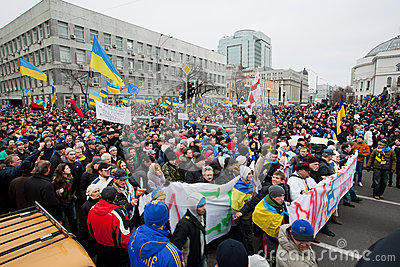 KYIV, UKRAINE: Huge crowd of men and women with different anti-government bunners walking down the street during protest Editorial Stock Photo