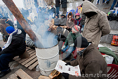 Young demonstrators burn fires in barrels, they oc Editorial Photography