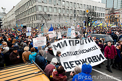 KYIV, UKRAINE: Thousands of active people with anti-government bunners rushing to the biggest meeting during the protest Editorial Stock Photo