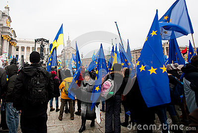 KYIV, UKRAINE: Woman walk past the crowd of demons Editorial Stock Photo