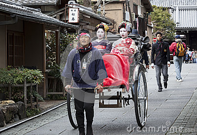 Geishas in a Rickshaw Editorial Stock Photo