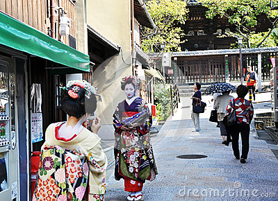 KYOTO, JAPAN - OCT 21 2012: Japanese ladies in traditional dress Editorial Image