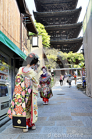 KYOTO, JAPAN - OCT 21 2012: Japanese ladies in traditional dress Editorial Photo
