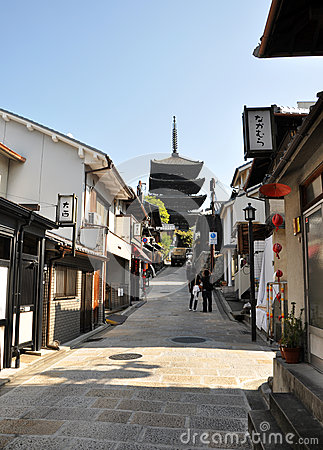 KYOTO, JAPAN - OCT 21 2012: Tourists walk on a street leading to Editorial Stock Photo