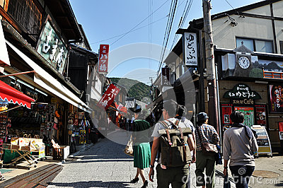 KYOTO, JAPAN - OCT 21 2012: Tourists walk on a street leading to Editorial Image