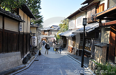 KYOTO, JAPAN - OCT 21 2012: Tourists walk on a street leading to Editorial Photography