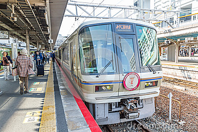 KYOTO - OCT30, 2013: Travelers train at Kyoto railway station  i Editorial Stock Photo