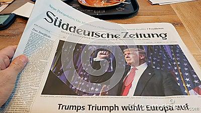 Läsa i tyskt kafé om den Donald Trump segern