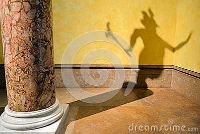 l 39 ombre du diable sur le mur photo stock image 45821122. Black Bedroom Furniture Sets. Home Design Ideas