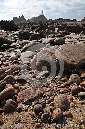 Free La Corbiere Lighthouse With Rocks Jersey Royalty Free Stock Photography - 65090667